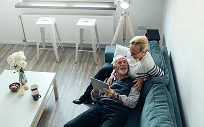 How do you repay a reverse mortgage? Senior couple in their home.